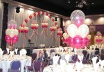 headtable decor, stage arch and centerpieces make this event pop.