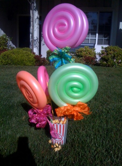 Lollipop Centerpiece with popcorn container, bright bows and colorful sticks